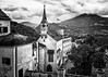 Saint George's Chapel (Tony Steinberg Photography) Tags: tonysteinbergphotography blackandwhite bw monochrome white black past culture cultural heritage medieval beautiful scenic peaceful travel history historical landmark image photo scene europe austria salzburg hohensalzburgcastle festunghohensalzburg manmade structure architecture arch archway gothic building castle church chapel belltower spire roof tower clocktower tall landscape courtyard city hills horizon mountain sky clouds outdoors fineart art religion christian christianity faith god holy prayer religious worship famous touristattraction tourism stgeorgeâschapel
