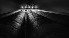 Concrete silo (Chas56) Tags: concrete silo structure architecture night longexposure shape texture urban lights canon canon5dmkiii northmelbourne lookingup backandwhite bw industrial pov scale