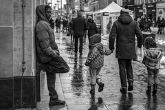 The Man on the Corner (Leanne Boulton) Tags: urban street candid streetphotography candidstreetphotography streetlife eyecontact candideyecontact man male face eyes look mood feeling leaning stance posture wall corner family children child passing wet reflection weather winter tone texture detail depthoffield bokeh naturallight outdoor light shade city scene human life living humanity society culture people canon canon5d 5dmkiii 50mm ef2470mmf28liiusm black white blackwhite bw mono blackandwhite monochrome glasgow scotland uk