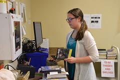DSC_0602 (Omaha Public Library) Tags: staff omahapubliclibrary omahapubliclibrarystaff saddlebrookbranch saddlebrook books checkingin aid libraryaid