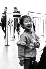 Eternal Sunshine of the Spotless Mind (Go-tea 郭天) Tags: xiamen kid child little girl smile smilling happy happiness lovely beautiful beauty cute sunshine pure candid portrait fun funny laugh laughing joy love inside indoor xiamenshi fujiansheng chine cn street urban city people bw bnw black white blackwhite blackandwhite monochrome naturallight natural light asia asian china chinese canon eos 100d 24mm prime enjoy enjoying young youth