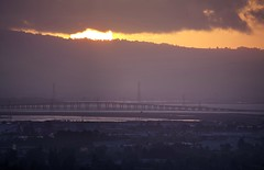 A sliver of the sun (PeterThoeny) Tags: fremont sanjose california siliconvalley sanfranciscobay sanfranciscobayarea bridge bay dumbartonbridge sunset sun goldenhour gold golden dusk sky cloud cloudy longlens sony sonya7 a7 a7ii a7mii alpha7mii ilce7m2 fullframe tamron tamronsp150600mmf563 1xp raw photomatix hdr qualityhdr qualityhdrphotography southbay fav100 landscape