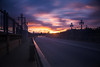 over the bridge (Andy Kennelly) Tags: pasadena coloradobridge sunset clouds colorful motion light lamppost suicidebridge