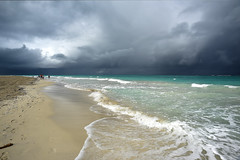 Getting Time to Leave! (Anthony Mark Images) Tags: varadero cuba carribean beach water ocean gulfofmexico shore shoreline sand footprintsinthesand waves threateneingsky cloudy raincoming rainclouds darkclouds clouds people seaweed sundaylights