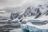Iceberg with mountains (Travels with Kathleen) Tags: lemairechannel antarctica water ice snow mountains icebergs clouds scenic nature
