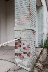 Respective light pink and very pale green paint ideas for a brick red column of bricks. (Tim Kiser) Tags: 2017 20171008 cadillac cadillacmichigan eastpinestreet img7846 michigan october october2017 pinestreet wexfordcounty wexfordcountymichigan brickcolumn brickred bricks coatsofpaint column corner crackedconcrete crackedpavement deterioratingpaint differentcoatsofpaint differentcolorsofpaint downtown downtowncadillac lightpink lightpinkpaint northernlowerpeninsula northernmichigan northwesternlowerpeninsula oldpaint paint paintedbricks palegreen palegreenpaint rust twocoatsofpaint verypalegreen verypalegreenpaint weeds weedsincracks
