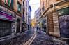 Narrow Street in Grenoble, France (` Toshio ') Tags: toshio france grenoble europe european europeanunion french people street store graffiti woman fujixt2 xt2