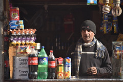 Sights (Batool Nasir) Tags: shopkeeper man shop selling light lahore pakistan gawalmandi looking afternoon softdrinks