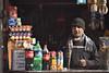 Sights (Batool Nasir) Tags: shopkeeper man shop selling light lahore pakistan gawalmandi looking afternoon softdrinks