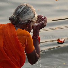 Graceful Spirit (designldg) Tags: india indiasong benares varanasi woman ganges ganga sacredrivers orange elder femininity beauty composition quietness atmosphere emotion ethereal dawn sunrise wet sari elegance square natural light culture corporeal corporeality contrejour colours water bath grace gracefulness soul focus photography people infinity timeless tradition travel river reflection eternity spiritual symbol dharma devotion dignity devotee faith hindu hinduism panasonicdmcfz200 ©laurentgoldstein theoldestlivingcityintheworld