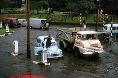 Rawtenstall,  Lancashire -  1964 (Lawrence Peregrine-Trousers) Tags: rossendale lancashire flood flooding cars motors 1960s motoring morris minor van ford thames trader austin j4