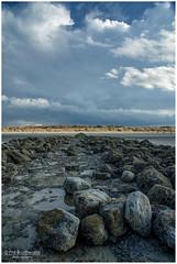 Breakwater rocks and the thunderstorm. (PhilBe) Tags: lombardsijde thunderstorm contrast rocks northsea noordzee dunes clouds