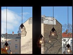 Lichtblick (onnola) Tags: berlin deutschland germany gwb guesswhereberlin lampe light glühbirne gitter fassade facade backstein brick brandmauer fenster window winter neukölln neuewelt café coffeeshop