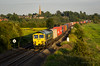 Pretty Much British (Wheelnrail) Tags: emd class 66 freightliner locomotive chiltern mainline main line train trains intermodal kings sutton sunset evening spring summer british uk united kingdom northamptonshire church steeple
