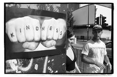 KINDNESS KNUCKLES (StockCarPete) Tags: knuckles kindness londonstreets uk london londoners baseballcap pasteup bw cambridgeheathroad