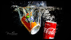 Twin splash (mik-shep) Tags: container cans tins cola water stilllife splash 117 containers 118picturesin2018 orange red tincan bubbles onblack colour colourful color