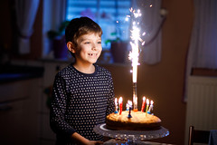 Adorable happy blond little kid boy celebrating his birthday. (romrodinka) Tags: wish 7 8 preschool schoolkid adorable beautiful birthday blowing boy cake candles caucasian celebrate celebration cheerful child childhood cute dessert dream european seven food four fun happiness happy holiday home indoor joy joyful kid laugh little make old one party preschooler present pretty smiling son sweet years family