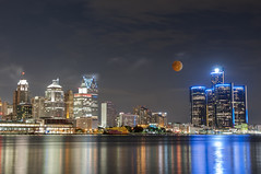Lunar eclipse and detroit skyline (Ncor: Photography) Tags: planet astronomical celestial astrometry bloody science solar world astrophotography sky mysticism omen concepts cosmos universe ideas eclipse moonlight religion cosmology space nature system crater forecasting natural fortune luna judgement surface red blood lunar telling day cosmic end full telescope significant total astronomy sign symbol night orange moon detroit skyline michigan city downtown cityscape architecture usa america skyscraper travel unitedstates water landmark urban reflection tower lake waterfront motorcity panoramic us skyscrapers renaissancecenter buildings detroitriver coast scraper