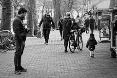 Carrot Trousers And An Approaching Giant (Alfred Grupstra) Tags: people blackandwhite street bicycle urbanscene men citylife outdoors cycling transportation editorial city modeoftransport walking groupofpeople big nl netherlands