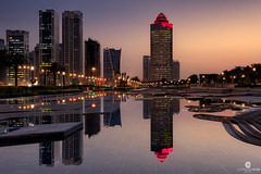 The city does not sleep and gets caught by the dawn - Doha (Qatar) (Juan María Coy) Tags: doha qatar skyline canon7dmarkii canonefs1585mm night noche sunrise amanecer dawn street calle urban ciudad city longexposure silueta arquitectura aire libre edificio building agua rascacielos skyscraper cielo sky grouptripod