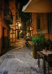 A nice place for dinner (Tiigra) Tags: cefalù palermo italy it 2018 balcony bike cafe cefalu laundry light night passage plant road rock sicily town