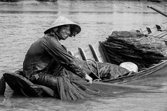 Smile and the world smiles with you (gambajo) Tags: fisher fisherman water boat river mekong vietnam delta smile happy work blackandwhite blackwhite travel people street streetphotography fischer boot fluss flus arbeit lachen