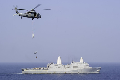 MH-60S Sea Hawk helicopters  participate in a vertical replenishment with USS Anchorage (LPD 23).