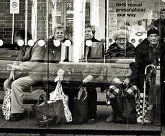 At the Bus Stop (Bury Gardener) Tags: monochrome mono burystedmunds bw blackandwhite britain 2018 nikond7200 nikon england eastanglia uk people peoplewatching folks suffolk streetphotography street streetcandids strangers candid candids