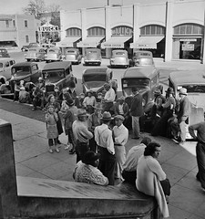Streetside Congregation: Outside the Labor Temple where the conference called by the Steinbeck Committee during the cotton strike is being held. Bakersfield, California. November 1938. (polkbritton) Tags: dorothealange 1930s californiahistory classiccars vintagefashion labor laborrights streetphotography