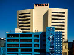 Murals To Go (Steve Taylor (Photography)) Tags: stork house carpark diamond togo mural graffiti streetart tag building fence brown blue orange newzealand nz southisland canterbury christchurch cbd city