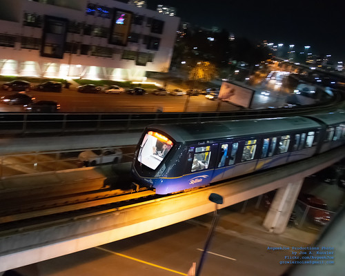 Panning Departing Mark III SkyTrain in Vancouver Night