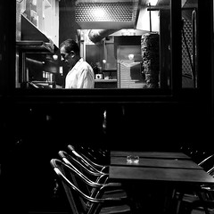 The cook (pascalcolin1) Tags: paris13 homme man cuisinier cook table nuit night lumière light vitre window photoderue streetview urbanarte noiretblanc blackandwhite photopascalcolin 50mm canon50mm canon