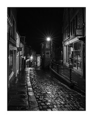 Catherine Hill (JRTurnerPhotography) Tags: sony sonyalpha sonya7riii a7r3 a7riii sonymirrorless jaketurner jrturnerphotography picture print image photo photography photograph photographer mirrorless mirrorlesscamera frome somerset england uk unitedkingdom gb greatbritain britain europe autumn november westcountry southwest catherinehill catherinestreet cobbles shops shopping highstreet town towncentre rain raining wet reflections blackwhite mono bw monochrome dark night nighttime longexposure
