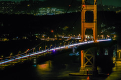 pacific face bridge work (pbo31) Tags: bayarea california nikon d810 color night dark black december 2018 boury pbo31 sanfrancisco city goldengatenationalrecreationarea marincounty northbay 101 goldengatebridge orange lightstream motion traffic roadway reflection over view repair construction crane