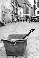 There's always work to do (auqanaj) Tags: 201808bis20180901 kodakgold200 nikonafnikkor50mm114d nikonf100 cewescanat72dpi street strase schwarzweis blackandwhite monochrome oldtown amberg mortartub mörtelwanne schaufel shovel people cobblestone composition baustelle constructionsite minimalism minimalismus analog film altstadt bayern bavaria deutschland germany oberpfalz upperpalatinate