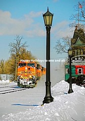 From me to you. (THE RESTLESS RAILFAN) Tags: snow bnsf orange station old sky blue clouds greeting holiday