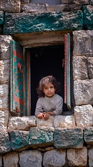 Village Girl.  (in explore) (Rod Waddington) Tags: middle east yemen yemeni girl culture cultural child window traditional architecture building house home towerhouses stone shutters village