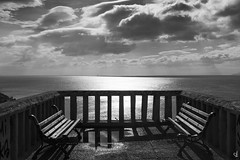Balcony with a view (tzevang.com) Tags: dramatic x100f fujifilm clouds sky benches daylight seascape piraeus greece bw