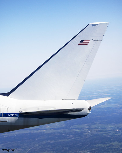 Logos of NASA and the German Aerospace Center (DLR) are displayed prominently on the tail of the Stratospheric Observatory for Infrared Astronomy (SOFIA) 747SP. April 26, 2007. Original from NASA. Digitally enhanced by rawpixel.