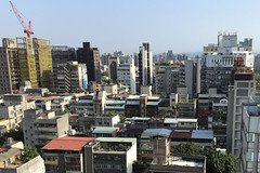 Taipei early morning. (neil.gilmour) Tags: taipei taiwan morning light buildings mountains gardens roofs offices apartments crane construction