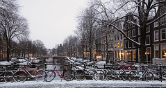 Amsterdam. (alamsterdam) Tags: amsterdam canal snow brouwersgracht bridge cars bikes houses architecture boats houseboats afternoon lights