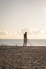Finding What Is Lost (dtravano) Tags: 50mmlens nikond3000 streetphotography photooftheday lightsandshadows colorsandtones beachtime vacation florida hollywoodbeach urbanstyle streetscene beachlife