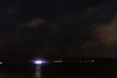 Spotlight on the bay (aerojad) Tags: eos canon 80d dslr 2018 landscape vacation travel wanderlust iceland2018 iceland autumn october outdoors reykjavík reykjavik night nightphotography nightscape longexposure clouds atlanticocean ocean stars star astrophotography auroraborealis auroras aurora boat boats motion motionblur