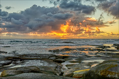 A fleeting glimpse (JustAddVignette) Tags: australia clouds cloudysunrise dawn deewhy flamingsky landscapes newsouthwales northernbeaches ocean orange reflections risingtide rocks seascape seawater sky sunrays sunrise swell sydney water waves