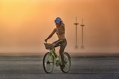Emerging from a Dust Storm (Jacques de Selliers (ON/OFF)) Tags: bike biker bikingwoman bicycle dust storm duststorm sunset burningman2018 burningman blackrockcity deselliers jacquesdeselliers beauties burningmanbeauties nicewomen beautifulwomen sexywoman burners