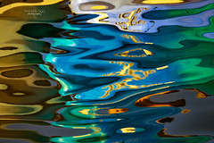 magic in water ... (mariola aga) Tags: lake water boats letters reflection distortion ripples art magic abstract