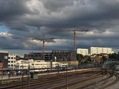 My commuting station (Elisabeth Redlig) Tags: stockholm sweden elisabethredlig train commuters commuting station constructions clouds tracks platform houses cranes buildings