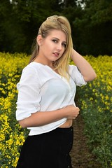 Vision in the Yellow. (pstone646) Tags: youngwoman younglady sexy people portrait pretty blonde outdoors blueeyes nature field yellow flowers