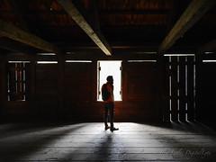 how the light gets in (DigitalLyte) Tags: howthelightgetsin wonderchild seethemusic man child son light rays building wooden cracks silhouette shadows