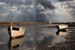 The tide is turning (Brancaster Staithe) (Glenn Birks) Tags: brancaster uk england boats tide sea clouds reflections norfolk staithe water coast north harbour national trust cargo fishing